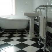 professionally tiling service retro black and white bathroom