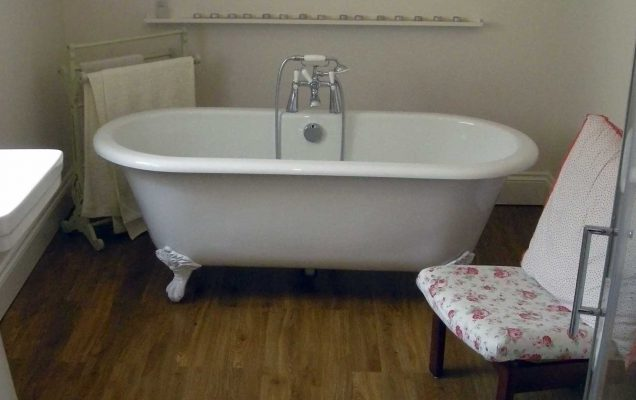 classical bathroom with white roll top bath