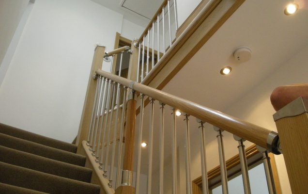 hallway and staircase with plastered walls and ceiling