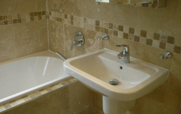 professionally plumbed bathroom with hidden pipes